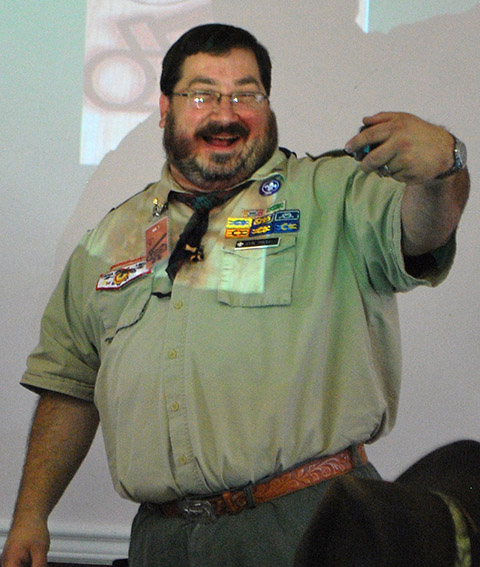 SM John Trichell checks out his new belt buckle, bedazzled for his position.